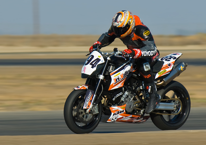 Eric GoGo Gulbransen at speed at Buttonwillow raceway on a KTM 990 Superduke